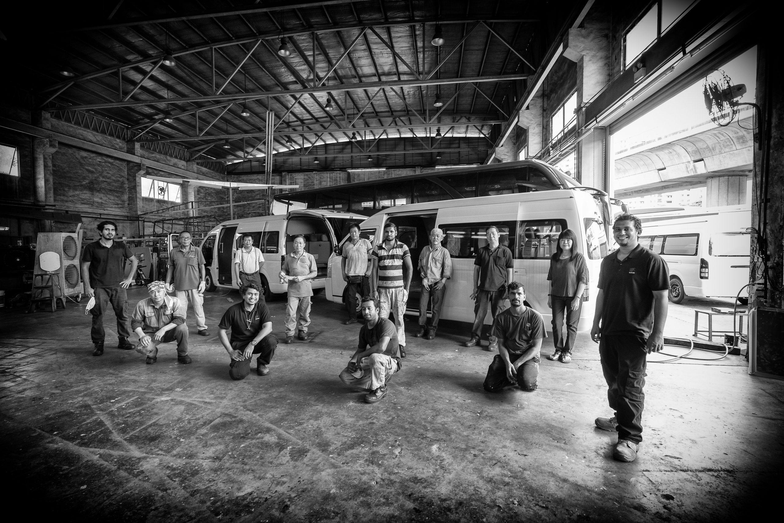 Meet the Aven-gineers: Back row, left to right: Mr Wong Fook Kam, 65, Finishing/Housekeeping from Liannex Corporation; Mr Chan Kong Song, 54, factory manager, Liannex Corp; Mr Chong Siew Yin, 56, Welder, Liannex Corp; Mr Heng Meng Seng, 49, air-conditioner installer, Cool-Air Technology; Mr Kariyaiyan Rajesh Kumar, 34, panelling, Liannex Corp; Mr Tan Kian Keong, 53, welder, Liannex Corp; Mr Yeh Kooi San, 47, mechanic, Liannex Corp; Ms Ellice Ng, 58, sales manager, Liannex Corp. Front (L-R): Mr Mulleri Jithin, 26, electrical technician, Liannex Corp; Mr Han Tian Wei, 40, mechanic, Liannex Corp; Mr Vicneswaran Naidu, 35, head of TRIGEN Automotive, HOPE Technik; Mr Kariyaiyan Rajesh Kumar, 34, panelling, Liannex Corp; Mr Muruganandham Samiayya, 33, panelling, Liannex Corp; Mr Kuzhanthaivel Prabu, 40, panelling, Liannex Corp; Mr Vinoth Pannirsilvam, 32, lead engineer of TRIGEN Automotive, HOPE Technik.
