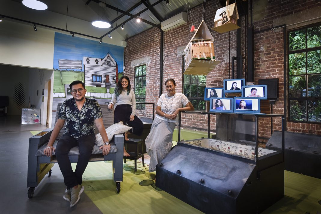 (L-R) Sign of the Times: Mr Imran Mohamad, director of operations; Ms Melissa Tan, intern; and Ms Charlotte Goh, executive director, with the rest of the team from Playeum seen on laptop screens. Playeum is an independent charity that develops life skills in children through play, creativity and the arts.