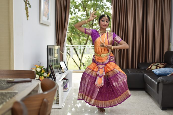 "Ms Ahtherai Rashasegaran, 27, has been taking dance classes at Bhaskar's Arts Academy since she was six years old. With lessons now cancelled, she participates in weekly online classes where they practise hand and leg movements, but it is the lack of meeting her fellow dancers in person that Ms Ahtherai misses the most. ""I'm sad that there isn't the same human interaction. Online classes can never replace the real thing. Dancing is not just about the art. This is both a social and therapeutic routine for me; something that I look forward to weekly,"" said Ms Ahtherai, who works as a nurse. Photo by: Caroline Chia"