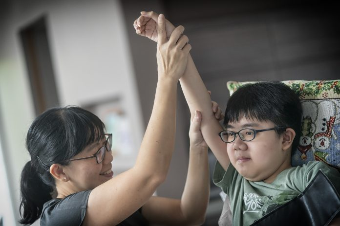 Daniel Sng, 15, was diagnosed with Duchenne muscular dystrophy (DMD) at six and needs daily physiotherapy with the help of his mother, Mrs Janice Sng. To deal with the challenges of Daniel's condition, the Muscular Dystrophy Association gave the family support at the early stages after the diagnosis, and linked them to other parents.