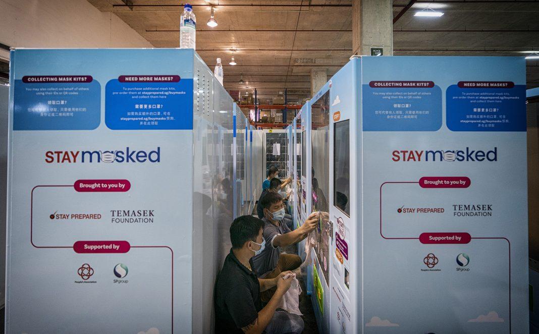Teams prepare mask vending machines