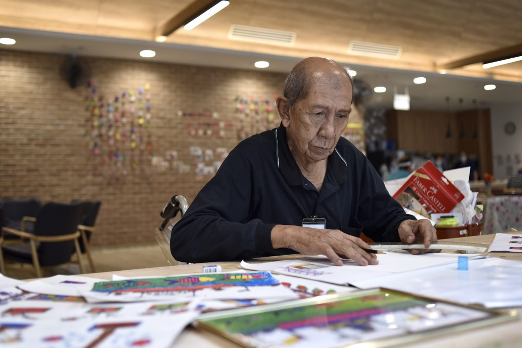 Mr Matlisah bin Chela enjoys art therapy at the Assisi Hospice Day Care Centre