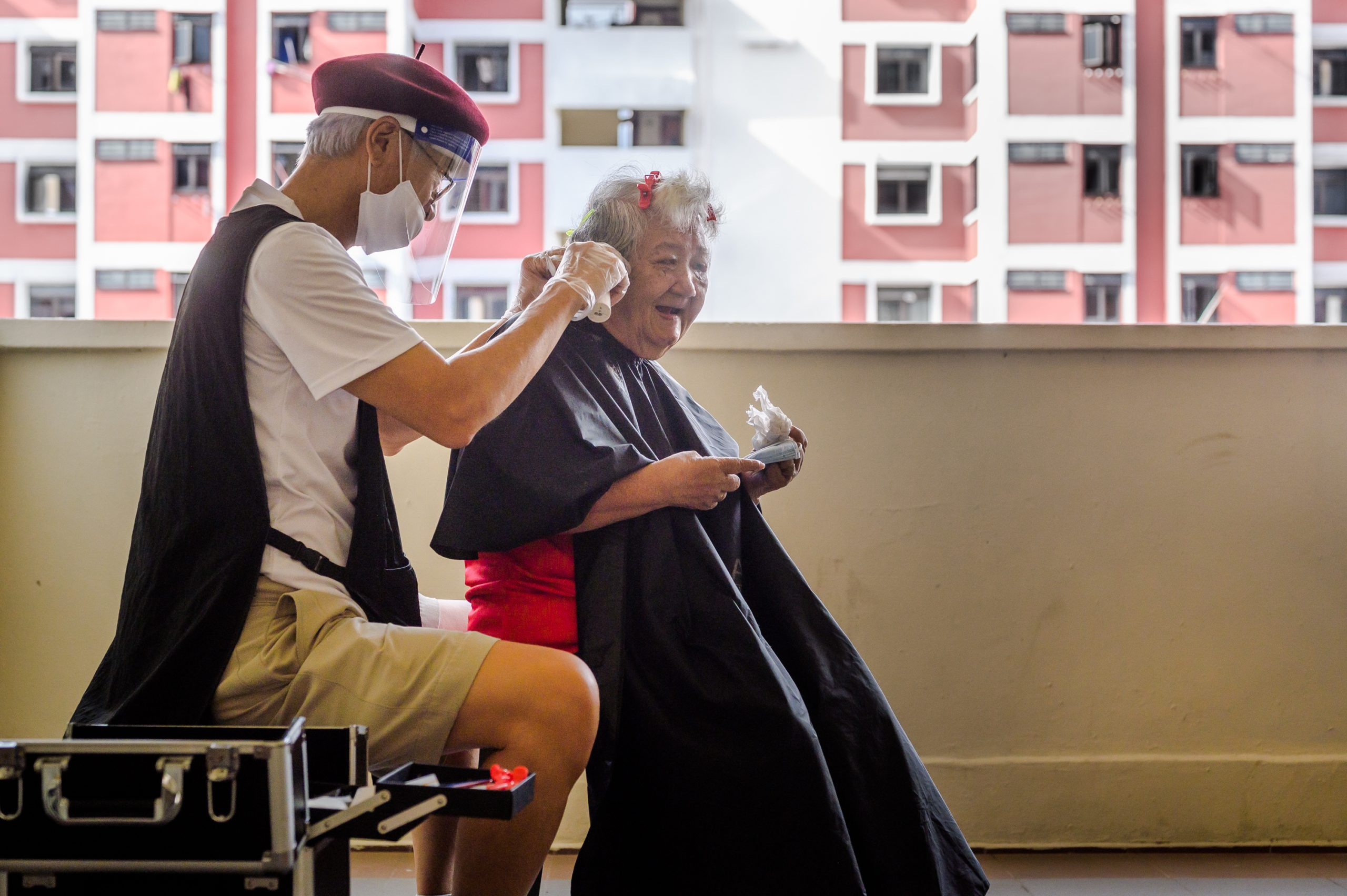 "Mr Mark Yuen, known as Uncle Mark among volunteers, is a trained hairdresser who knocks on doors to ask if residents need haircuts. If they are sufficiently mobile, he brings them out of their dimly lit homes and corridors to ""set up shop"" at one of the staircase or lift landings where there is sufficient light"