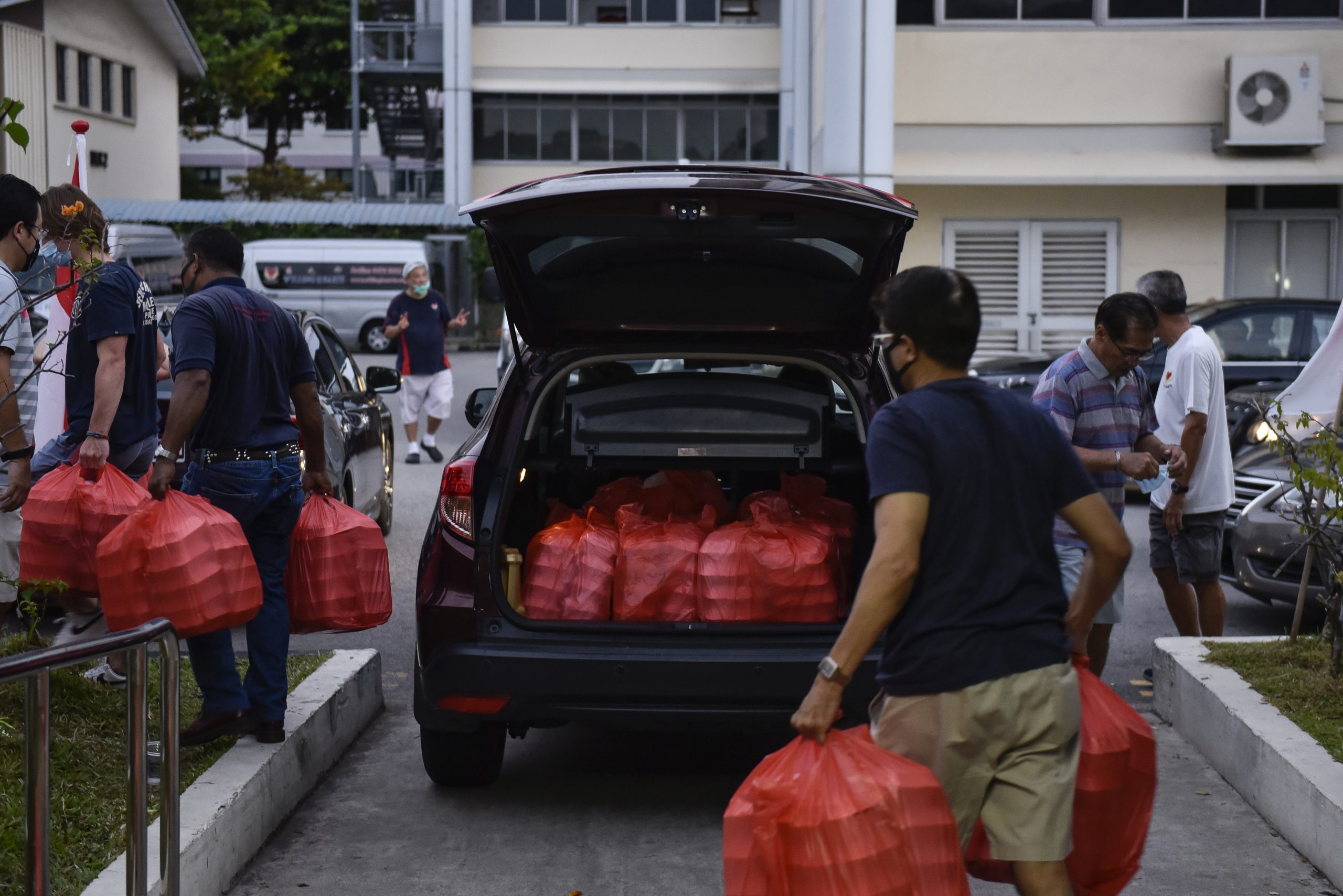 All packed meals are loaded into private cars, taxis, vans and lorries fill the driveway at collection time, bound for their respective distribution points. Mr Tay makes a food delivery in the morning too, after supervising work in the kitchen.