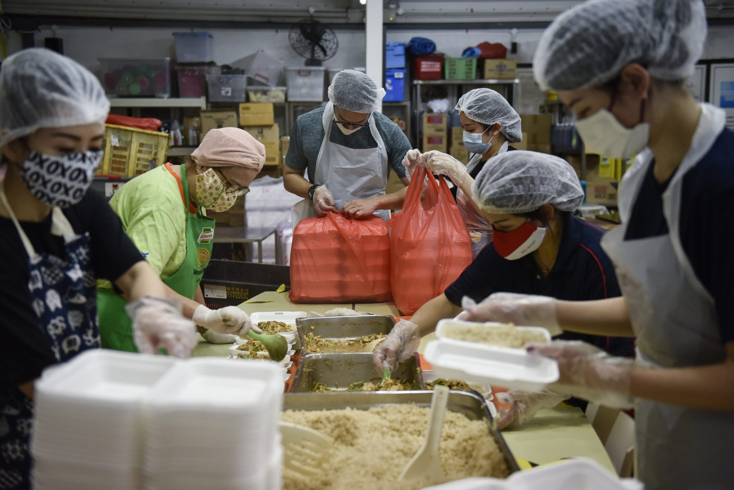 Volunteers packing food have to wear a hairnet, apron and gloves, which are all provided at the kitchen. To give volunteers more flexibility, there are four shifts each day that they can sign-up for online.