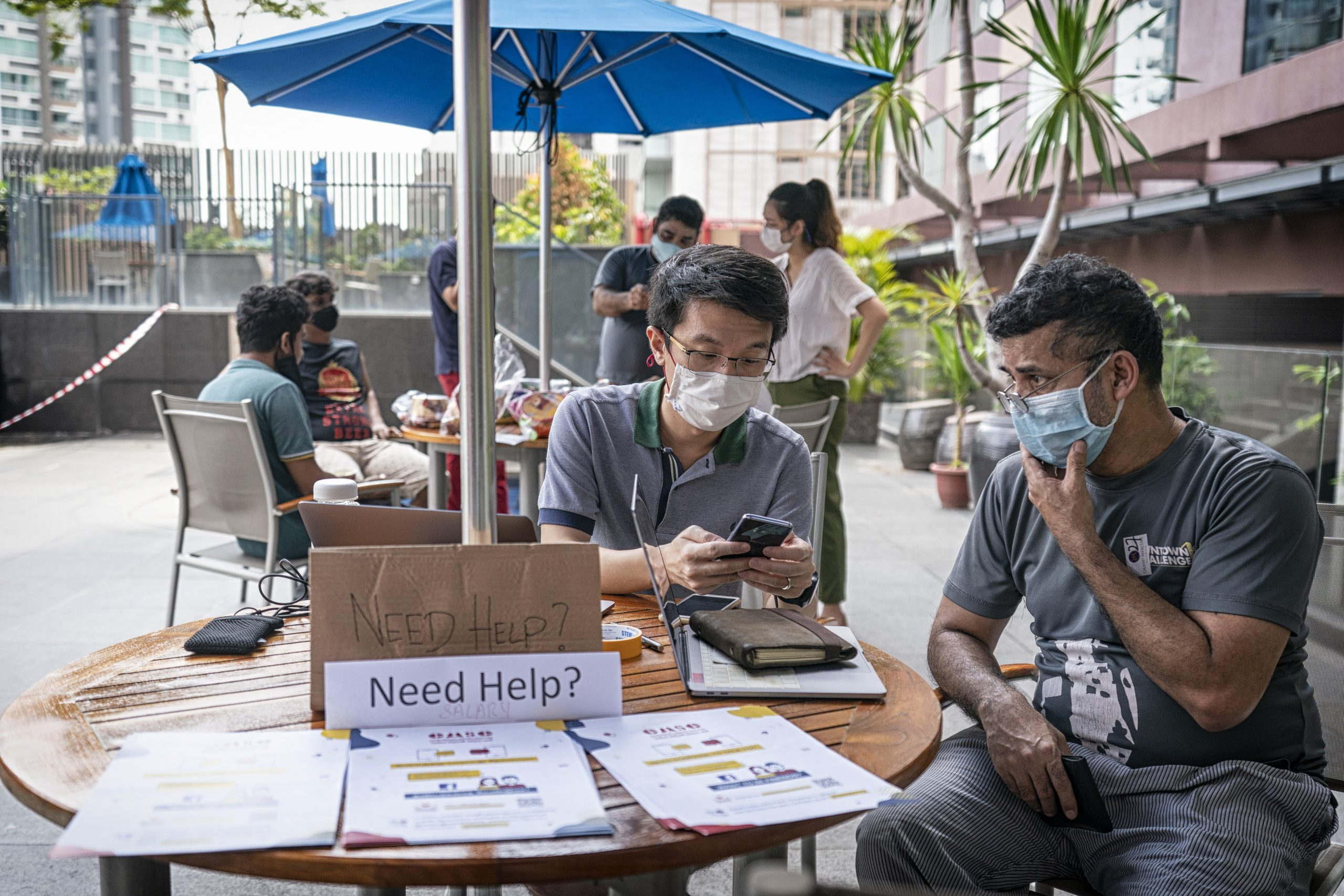 Help desks are set up to address questions and concerns of migrant workers — from enquiries about their salary and banking needs to making sure they can call their families when home sick. Digital ambassadors are present to help workers download, navigate and troubleshoot apps they need to return back to work.