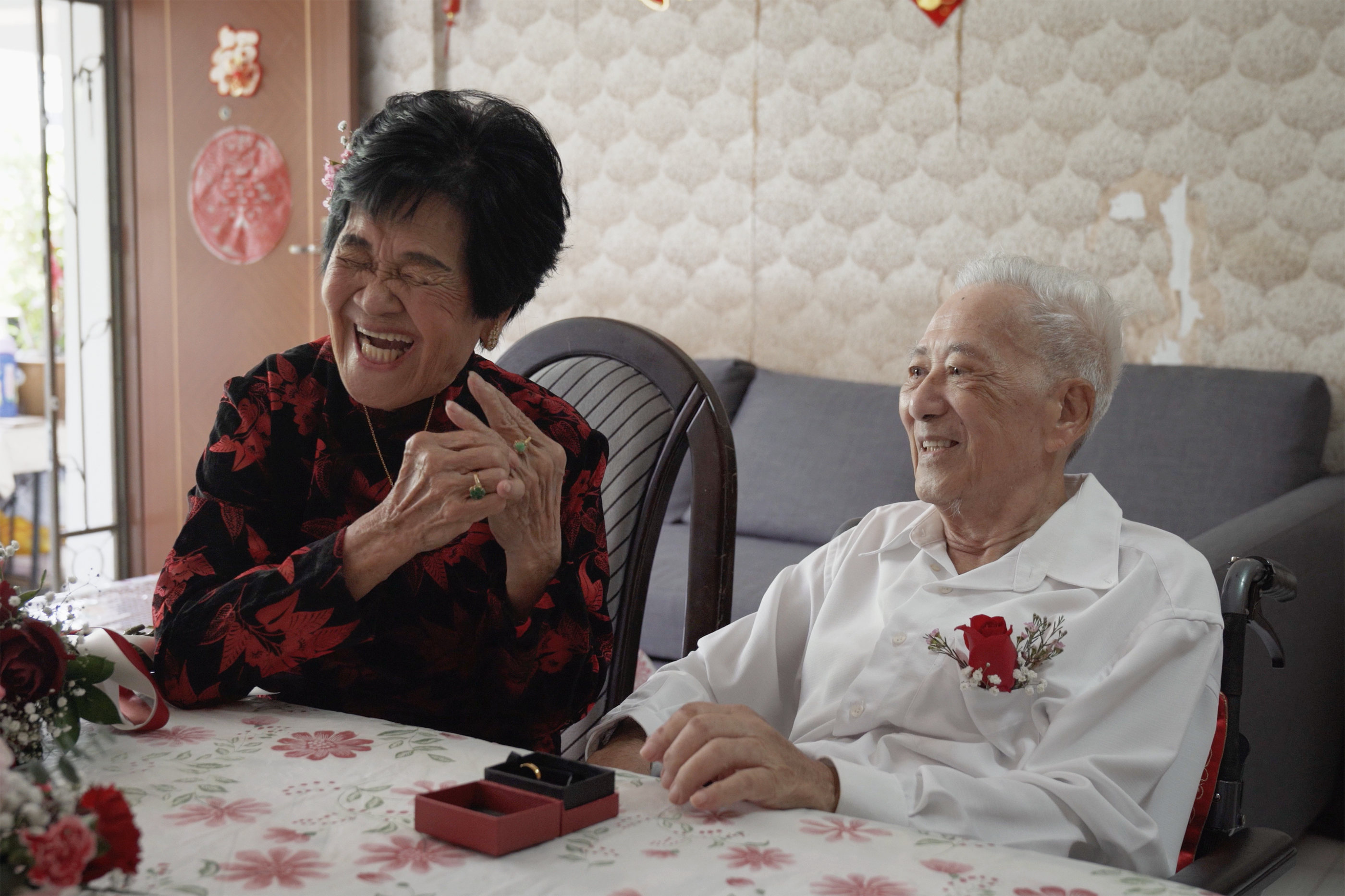 Madam Chia Pee Kim, 84 and Mr Tay Soo Hian, 86 exchange vows on their wedding day in August.