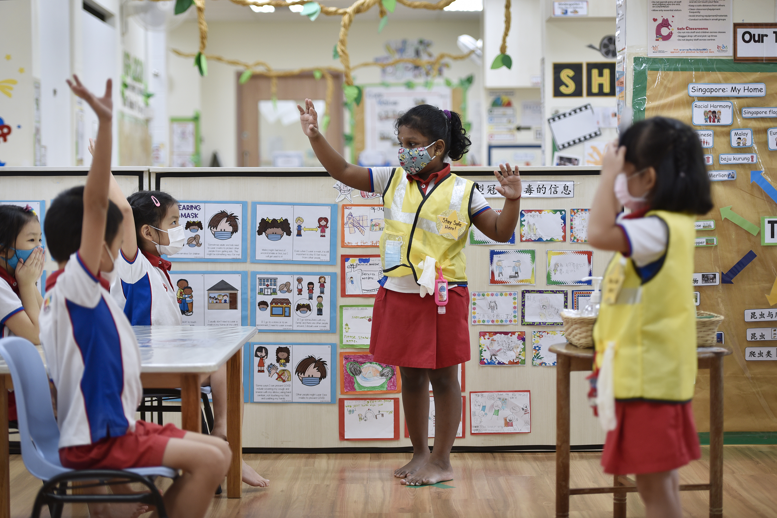 Six-year-old Lirthika Karthigayan, a Stay Safe Hero at PCF Sparkletots Braddell Heights, speaks to her K2 classmates about the importance of keeping their hands clean.
