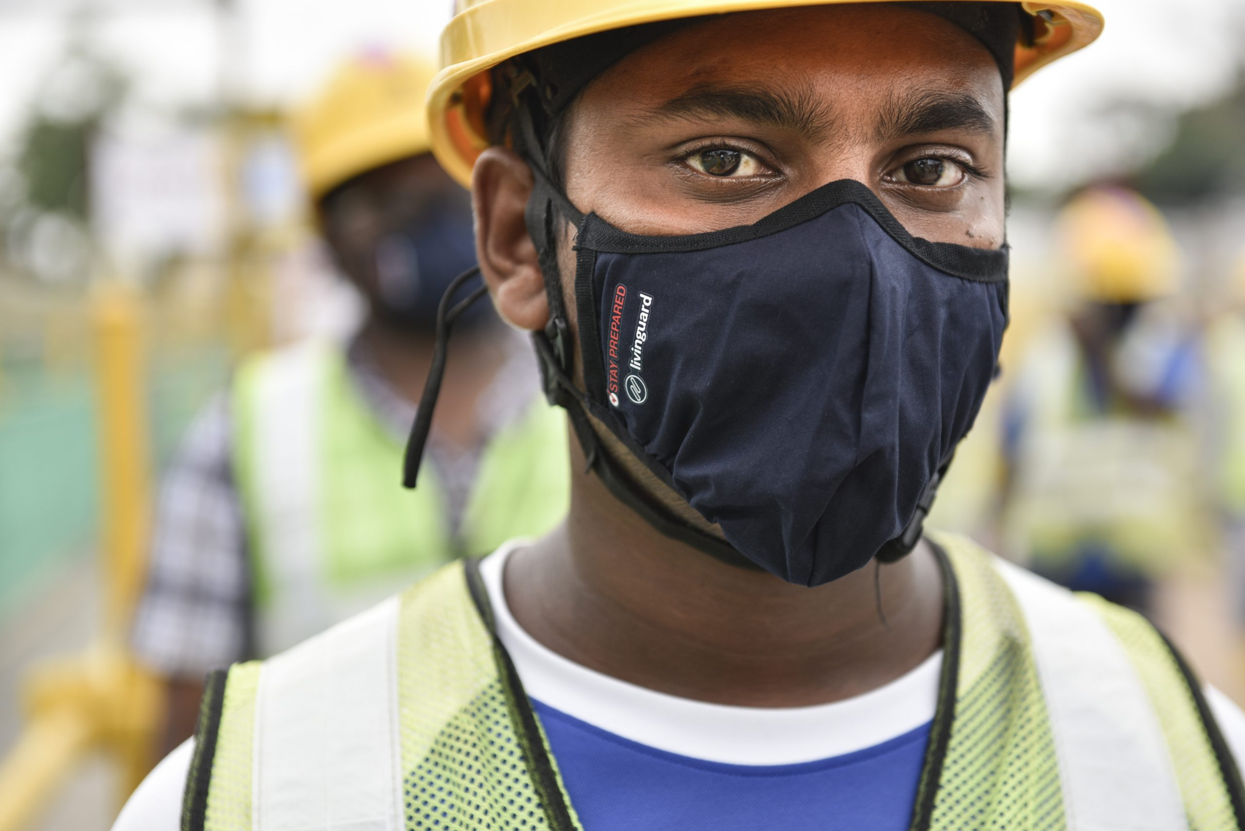 Indian national, Mr Neelakandan Kannan, 27, wears the reusable mask from Temasek Foundation. A total of 500,000 masks will be going to the built environment sector, and distribution is underway