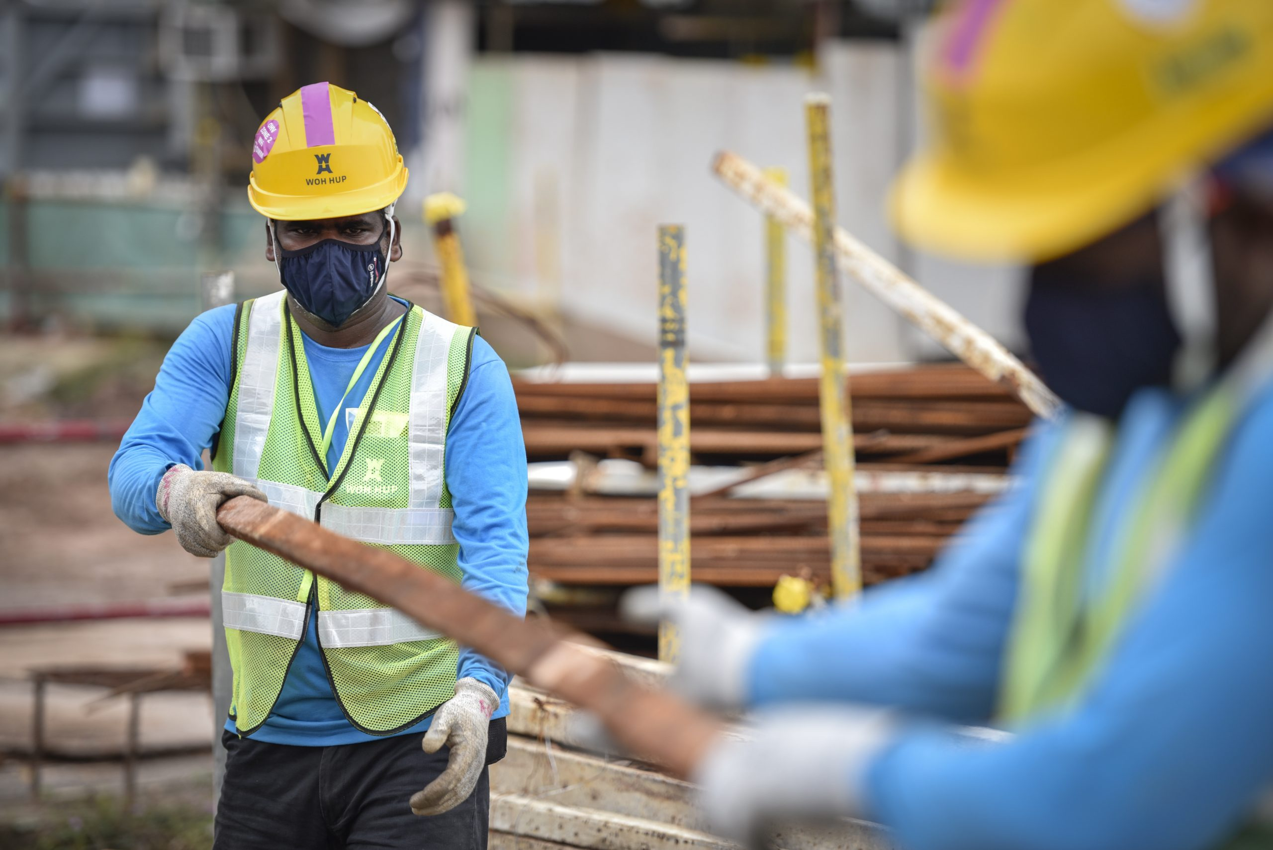Indian national, Mr Rajendran Samidurai, 35, wearing the reusable mask from Temasek Foundation at work on a site in Holland Village