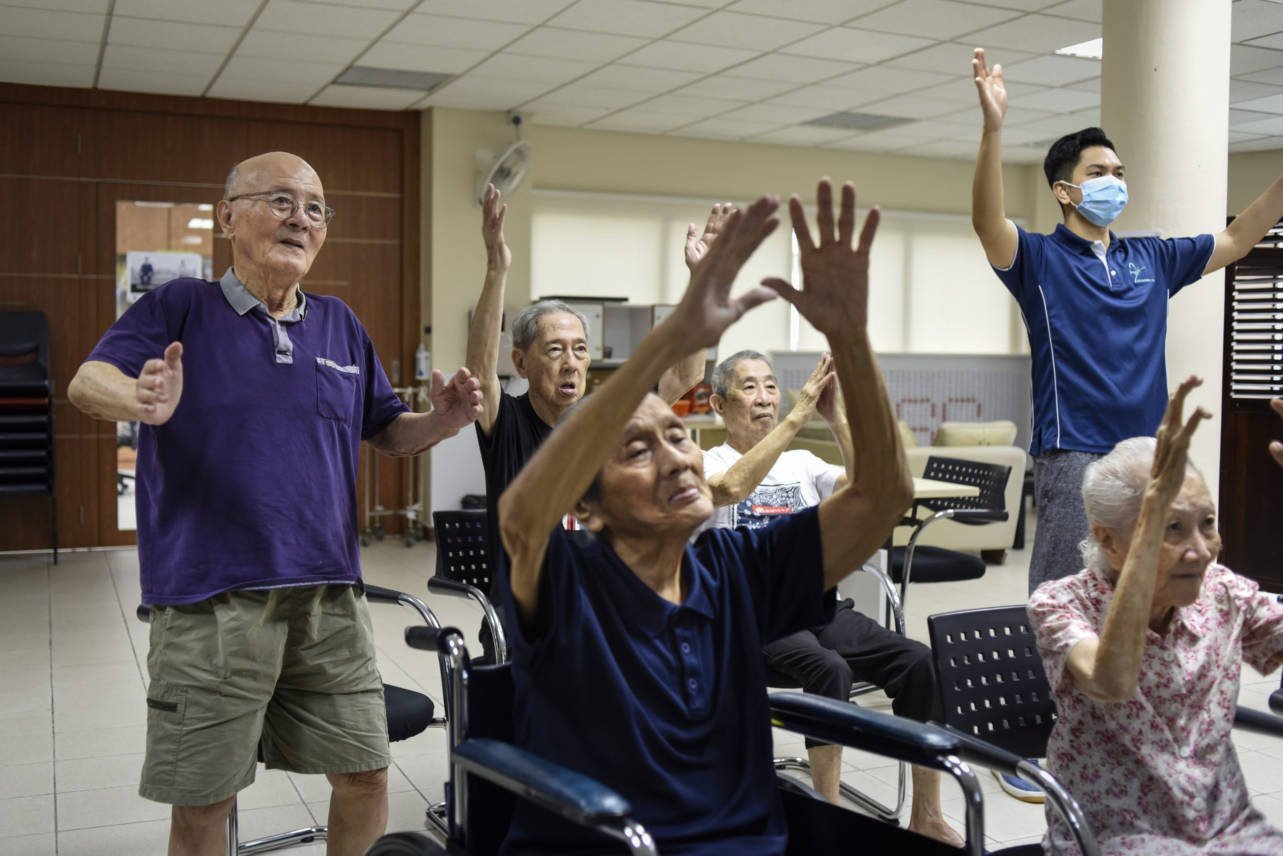 "(Left) Apex Harmony Lodge resident, Mr Seow Ching Khue, 83, dances along to the song, ""Take Me Home, Country Roads"", on a recent Thursday, as the hour-long online programme draws to a close."