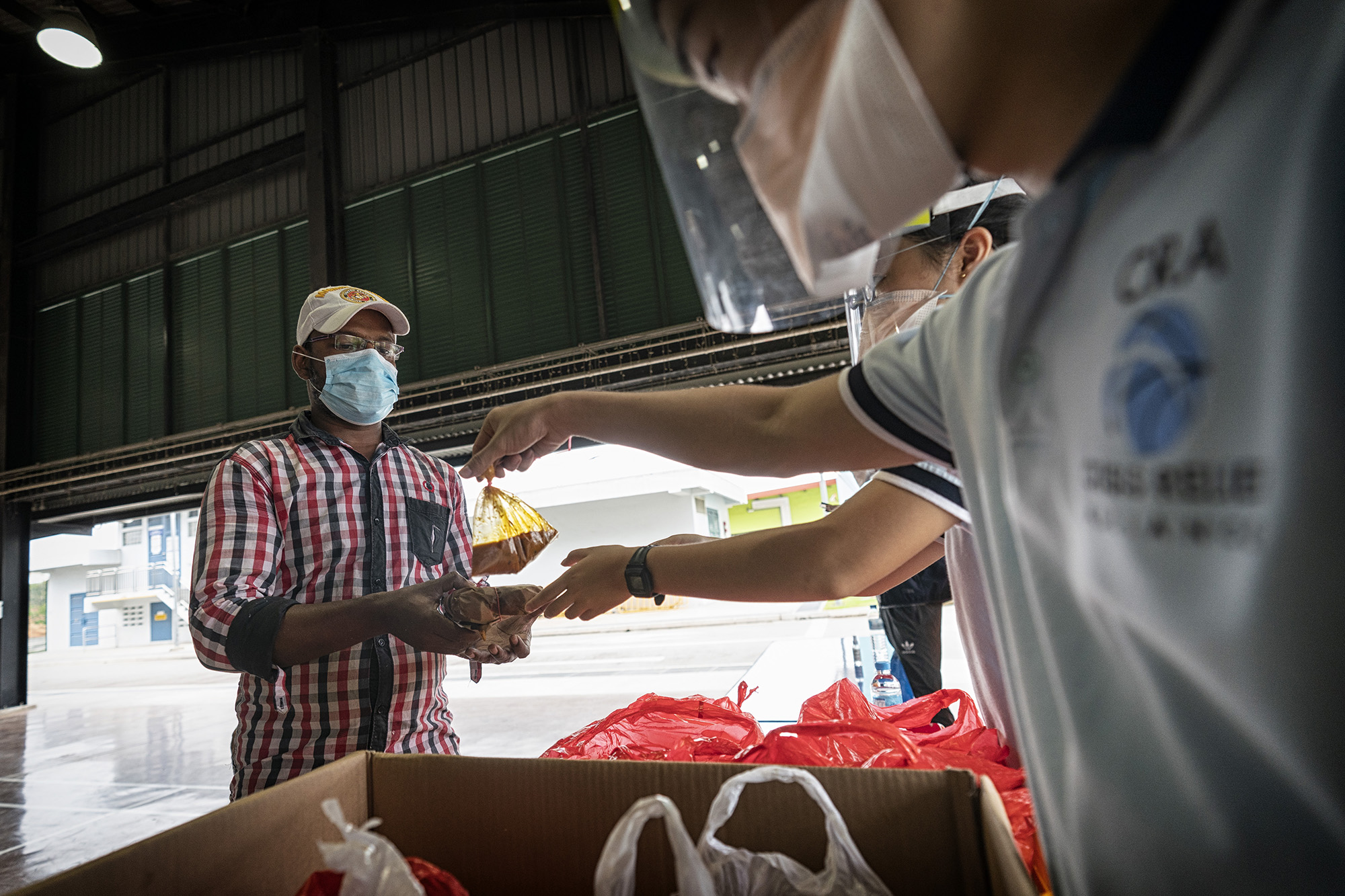 Crisis Relief Alliance distributes food to migrant workers for Deepavali 2020