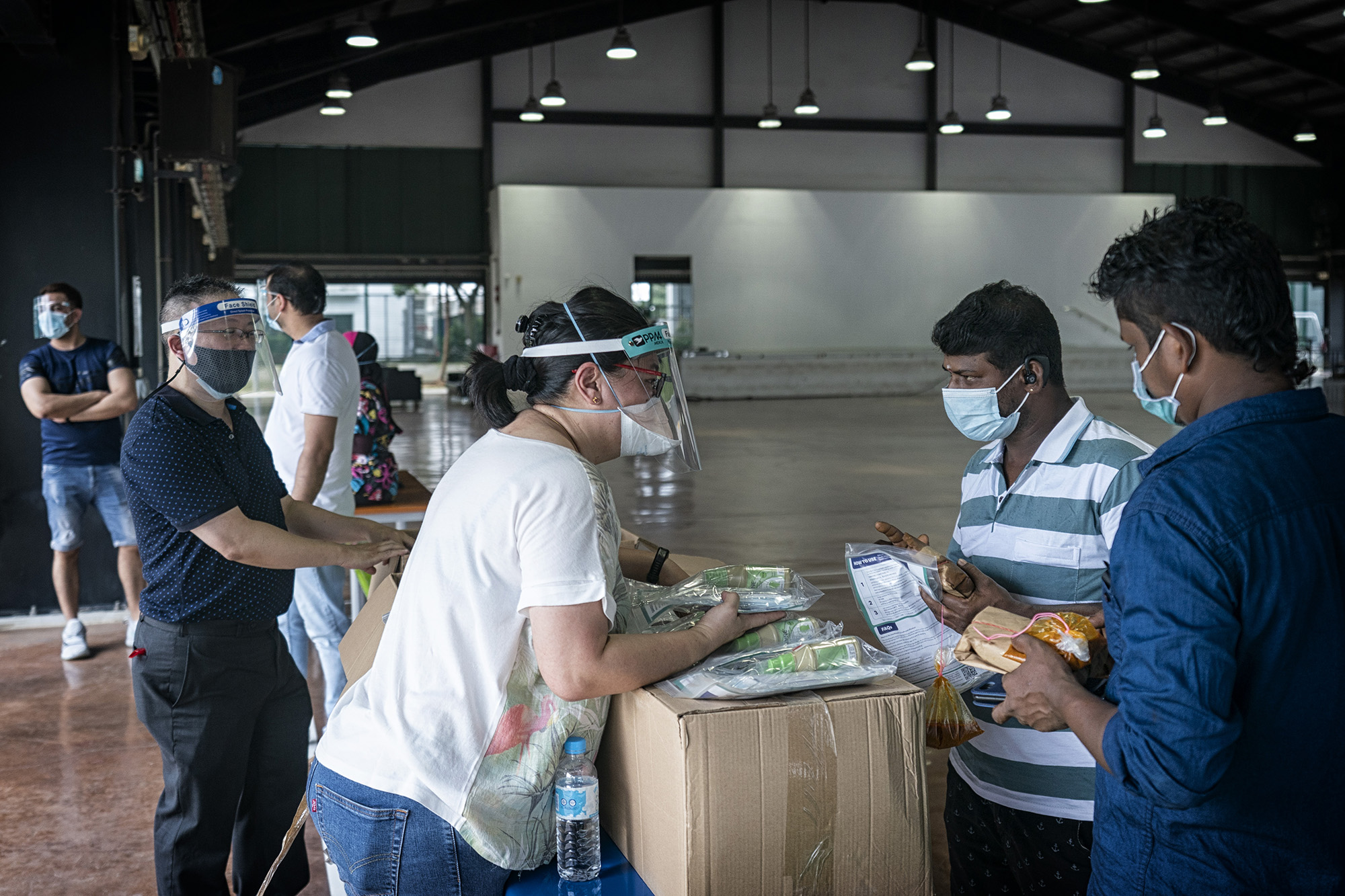 Crisis Relief Alliance distributes food and hygiene products to migrant workers for Deepavali 2020