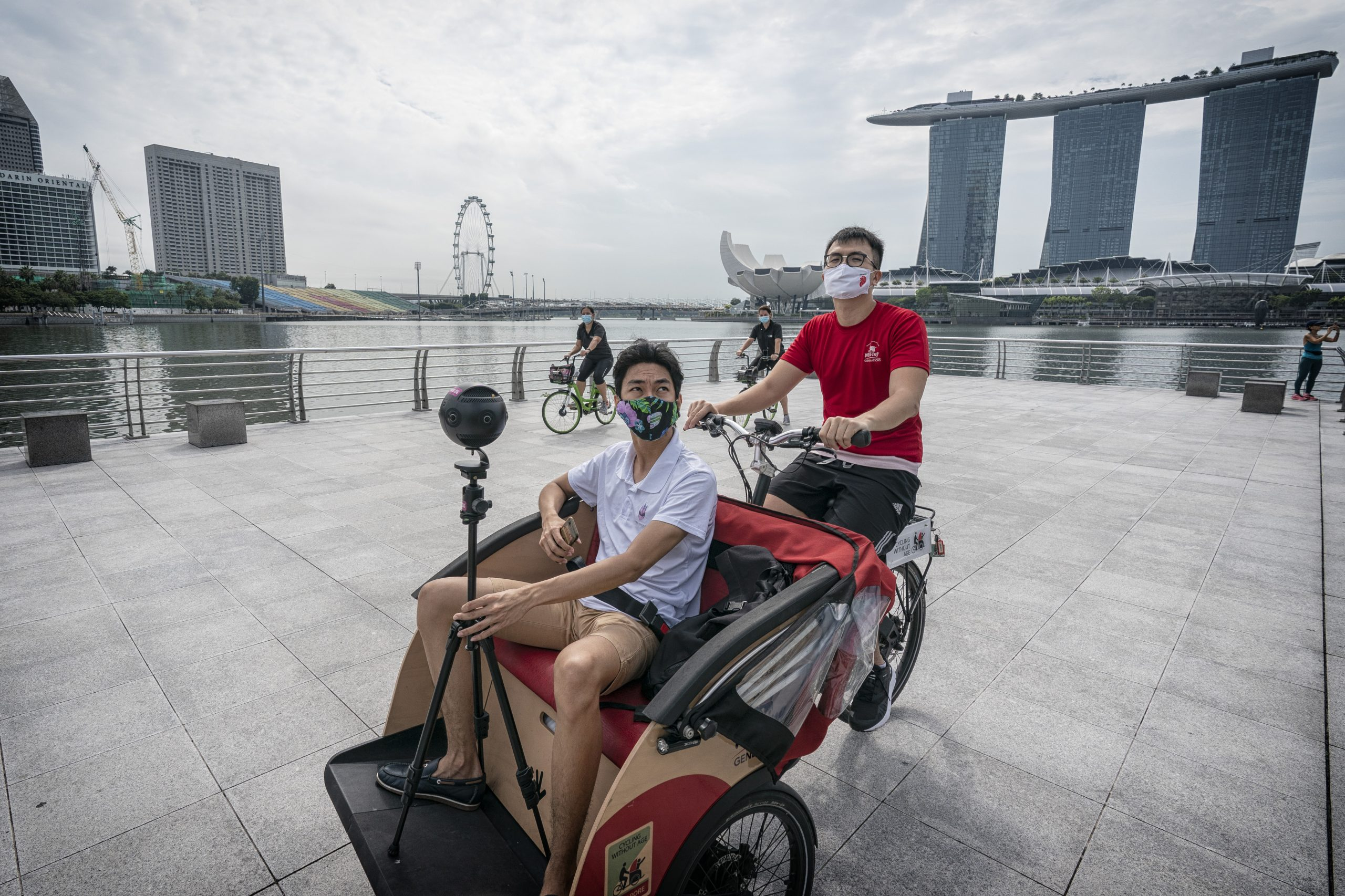 Volunteers from Cycling Without Age Singapore and Mind Palace journey through Singapore on trishaw while filming virtual reality content for residents in nursing homes