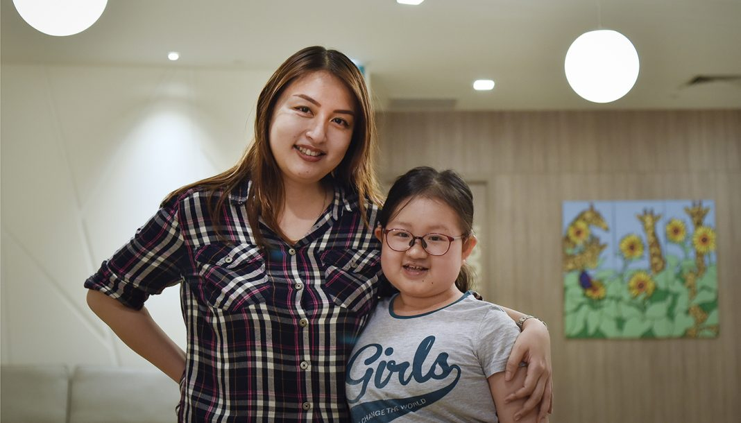 Children's Cancer Foundation beneficiary, Calista Lee (right) with her mother, Eveline Tan. Since the onset of COVID-19, Evelyn had to take extra care of Calista. Worried about her already weakened immune system, they had minimised outdoor activities. Instead, she often teaches Calista how to cook and bake as an alternative way to bond with her.