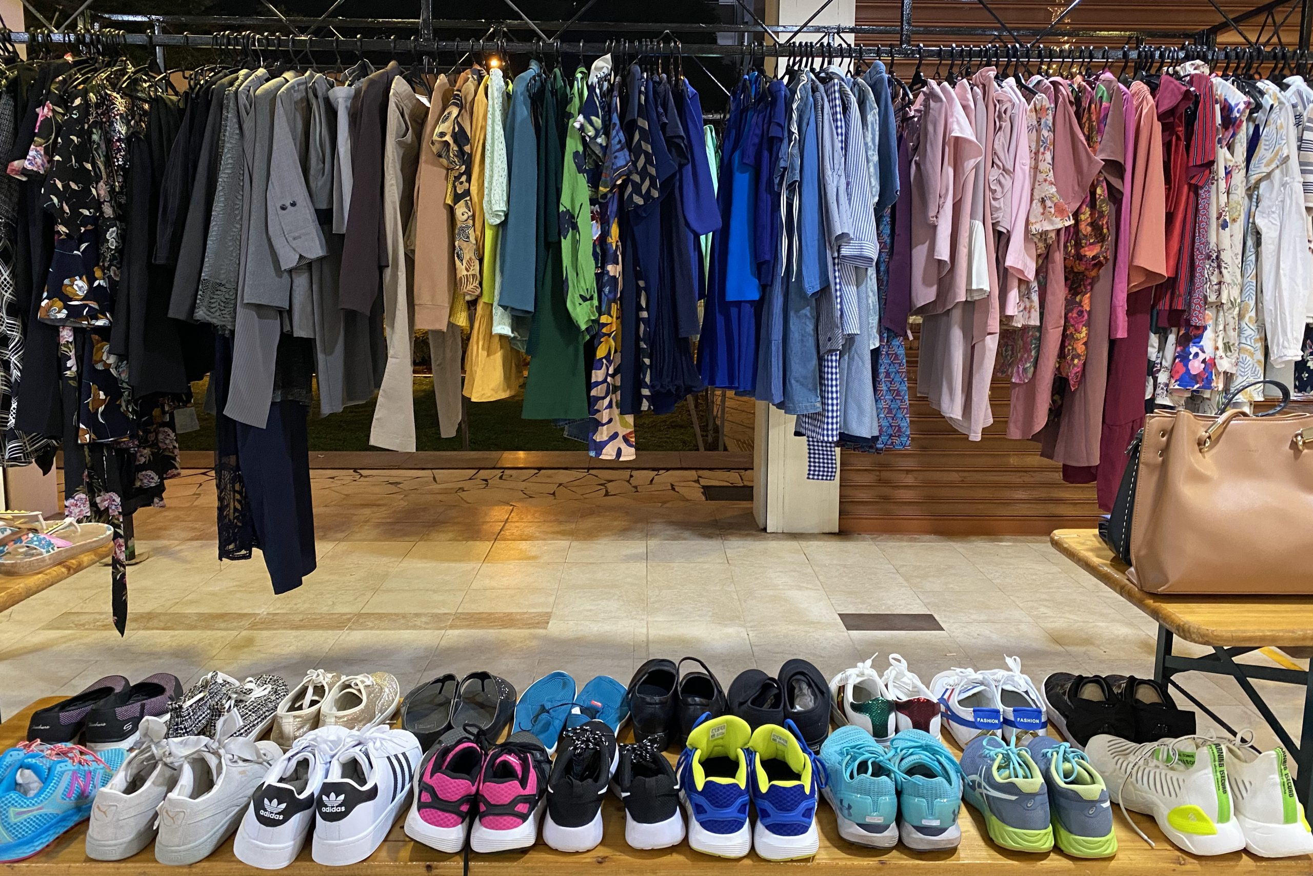 After many days of sorting and organising clothes based on their size and condition, volunteers finally settled on a colour-coded presentation that looked like something out of a departmental store.