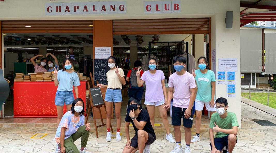 Youth from Cheng San Chapalang Club stand in front of the club at the Cheng San Community Club