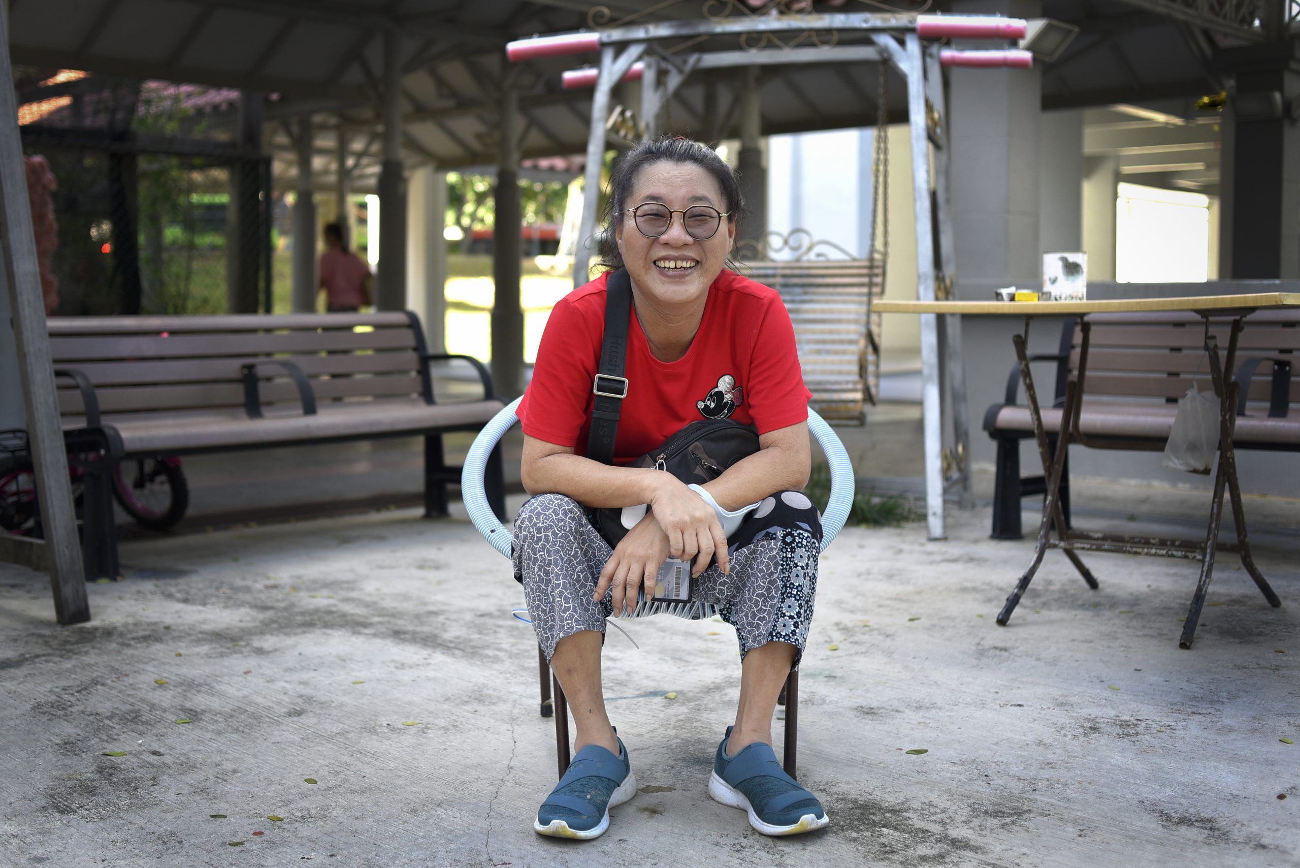 Madam Sandy Goh is a familiar face at the Senior Residents' Corner of Block 702 Bedok Reservoir Road. With the help of fellow residents, she coordinates frequent food distribution to various blocks in the area.