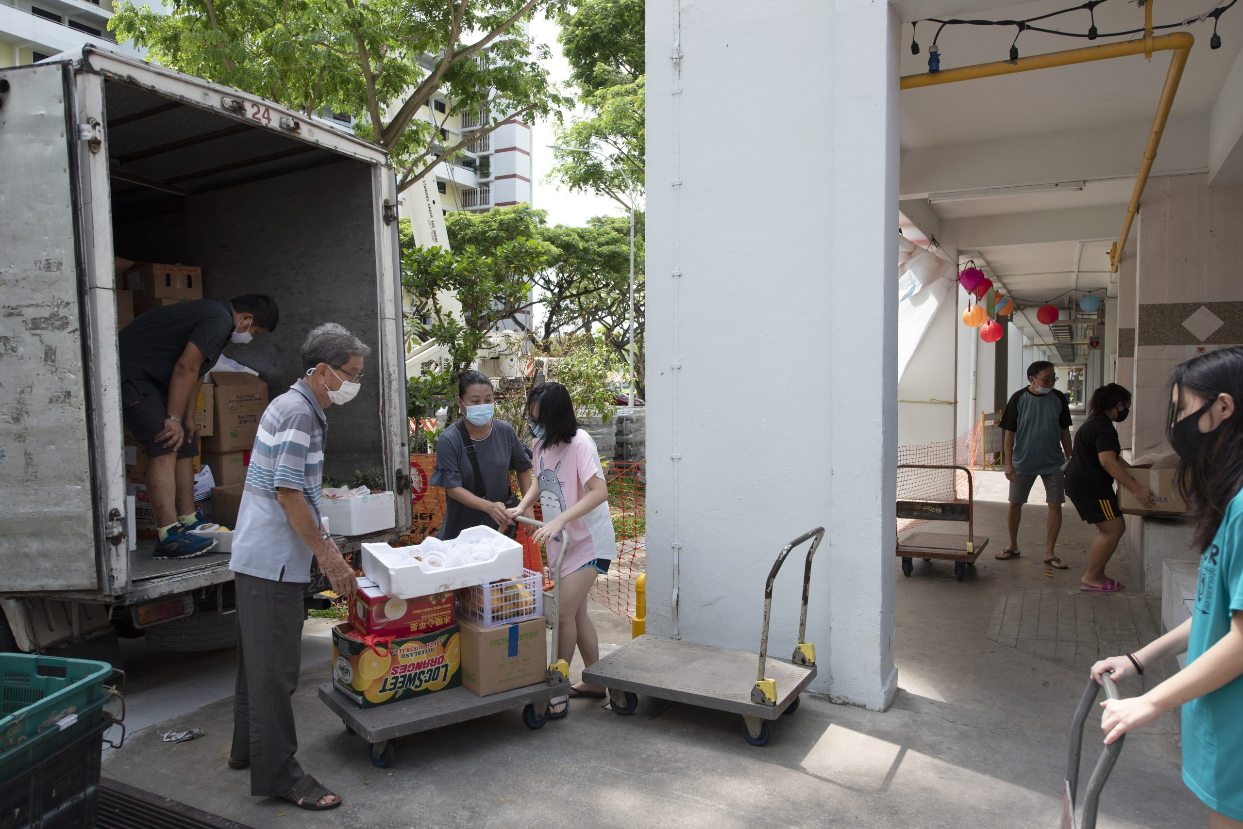 Residents help unload rescued produce from Fridge Restock Community SG. The rescued food is then laid out at the Senior Residents' Corner where anyone can take some for their own consumption. Most of the produce is usually taken with two to three hours.