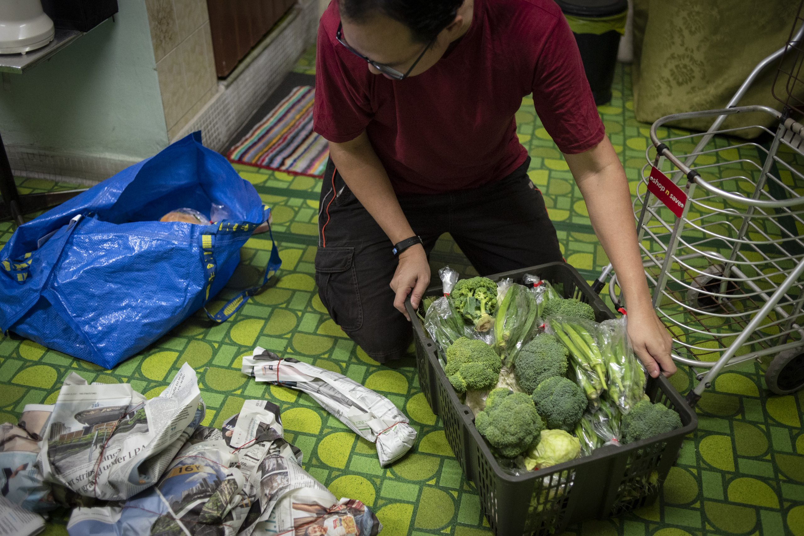 Daniel Tay, sorts out the rescued produce into smaller portions for distribution to friends and neighbours. His mother, who recently took to consuming rescued food too now looks forward to what he brings home.