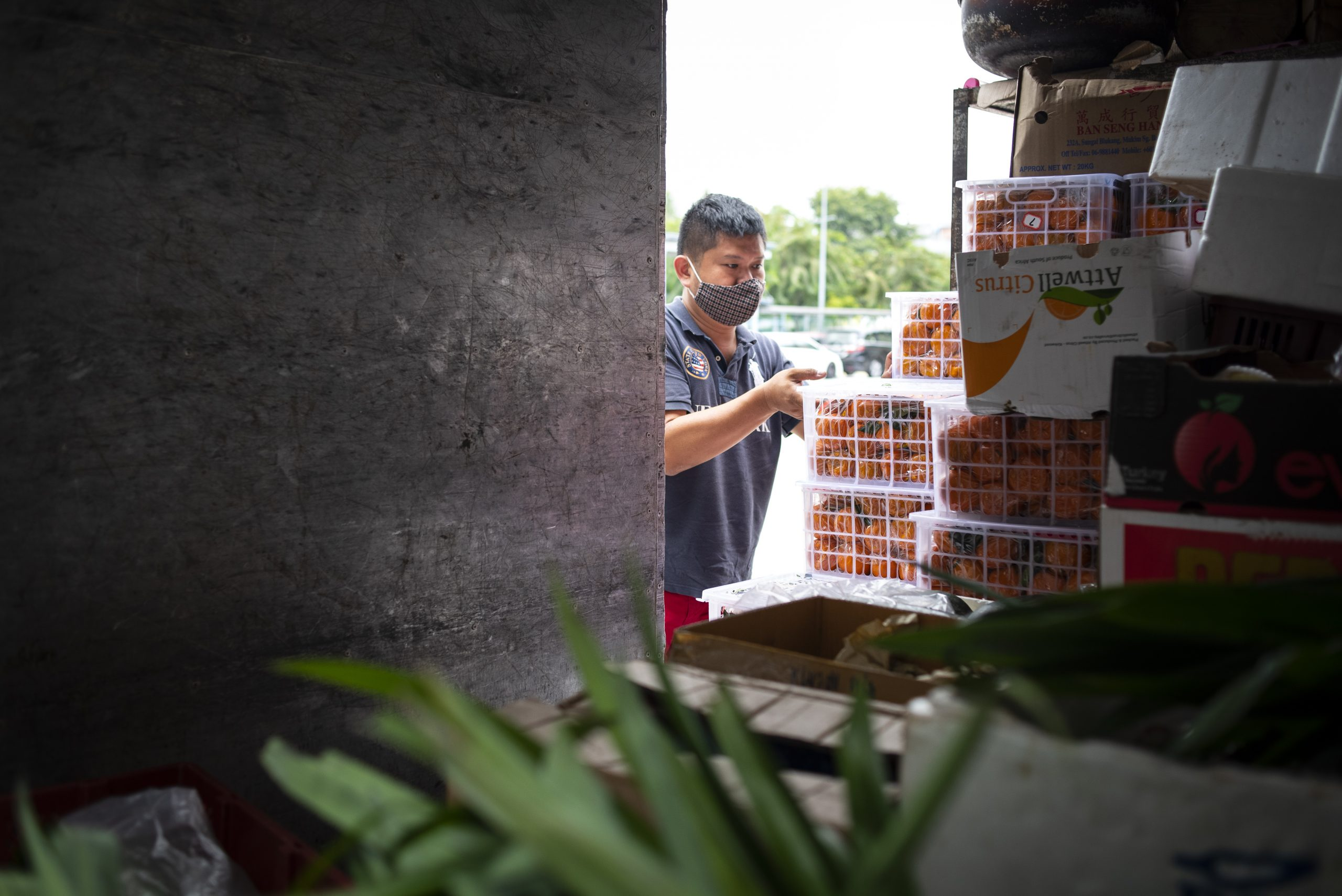"Daniel Yap, founder of Fridge Restock Community SG (FRC), sorting and unloading rescued produce from his lorry. FRC works with its network of about 10 ""freedges"" in neighbourhoods such as Punggol, Woodlands, Marine Terrace, Bedok Reservoir, Tampines, Teck Whye and Stirling, among others."